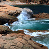 Waves gently crashing against the rocks at Acadia National Park