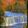Upper Tahquamenon Falls in full Autumn color this water fall is located near Paradise, Michigan.