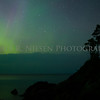 The aurora picks over a cloud bank over  Lake Superior at Hunter's Point, Copper Harbor, Michigan