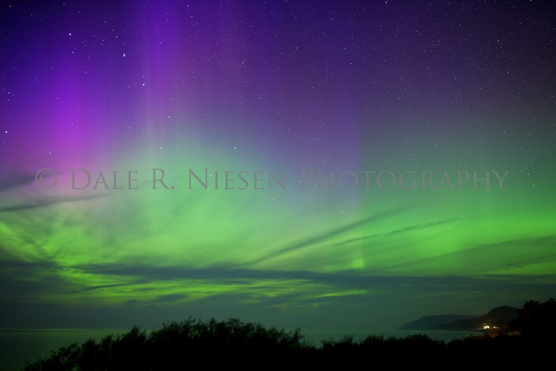 I waited 3 days for an opening in the cloud cover while on vacation near Empire, Michigan (Sleeping Bear Dunes National Lakeshore). A small hole opened on Monday night along with the aurora alerts picking up I headed out to the Lake Michigan shore at Empire. I saw one of the best aurora displays I have ever witnessed.  Taken 9/7/2015.