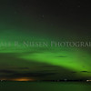 The Aurora also known as the Northern Lights and Big Dipper in the sky above the Straits of Mackinac with Mackinac Island at lower right of the view taken from Mackinaw City, Michigan on November 14, 2012.
